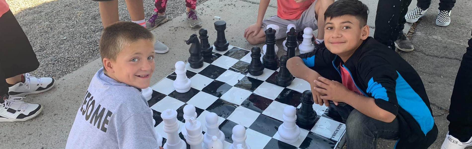 Students playing chess on the playground